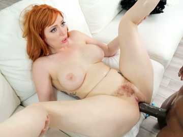 Redhead with hairy bush Lauren Phillips gives busty body in interracial sex