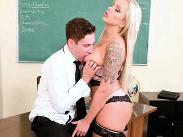 Guy in tuxedo gets mesmerized by Nina Elle's big tits and the ability to suck his dong