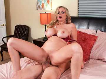 Extra busty MILF Julia Ann bounces on the strong young cock of son's friend