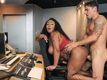 Voluptuous black lady Layton Benton rides hard white cock at music studio