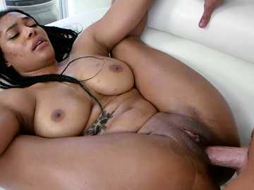 Huge-titted black girl Alison Sault copulates with the white man on the couch